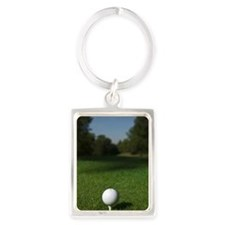 Golf ball beside hole at golf co Portrait Keychain