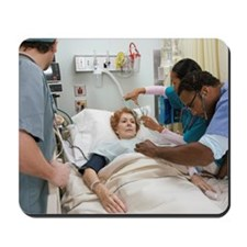 Medical Team Treating Patient Mousepad