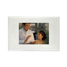 A male dentist holding Rectangle Magnet (100 pack)