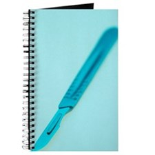 Surgical scalpel, close-up Journal
