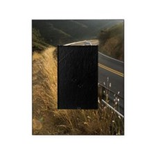 Car travelling round bend in road Picture Frame