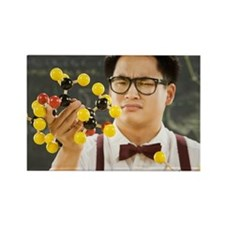 Nerdy Asian male student holding  Rectangle Magnet