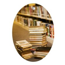Stacks of books in library Ornament (Oval)