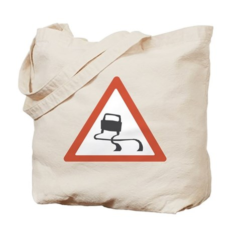 road sign slippery Tote Bag