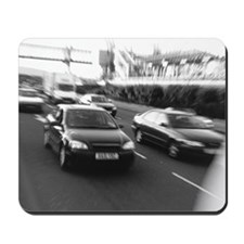 View of traffic moving in a street (black Mousepad