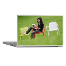 Girl sitting on plastic chair in mead Laptop Skins