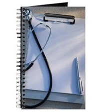 Stethoscope, clipboard and pen, studio sho Journal