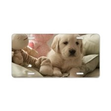 Dog relaxing on bed Aluminum License Plate