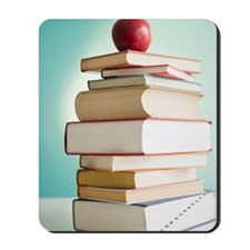 Apple on stack of books Mousepad
