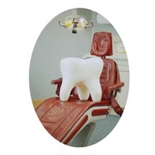 Giant tooth sitting on dentist's c Ornament (Oval)