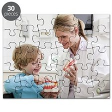 Dentist with boy in surgery Puzzle