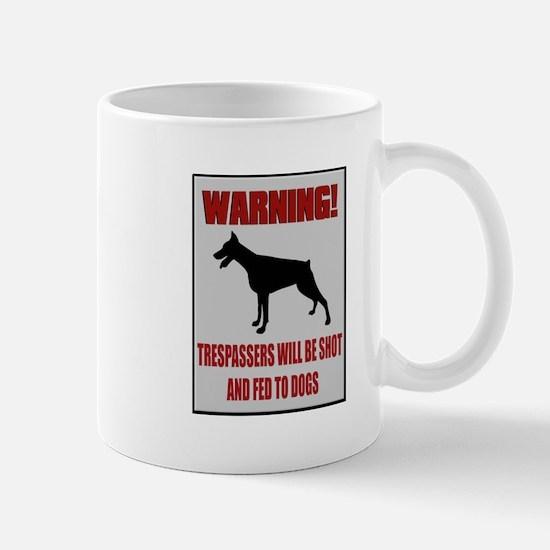 Trespassers Fed To Dogs Mug