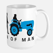 evolution of man farmer with a tractor Tasse