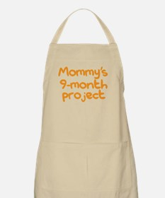 A new baby. Mommy's 9-month project. Apron