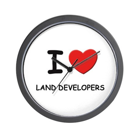 I love land developers Wall Clock