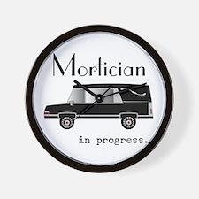 Mortician in progress Wall Clock