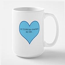 AUTISM has touched my life. Mug