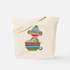 Sock monkey with popcorn Tote Bag