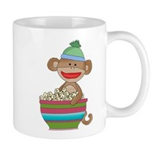 Sock monkey with popcorn Mug