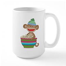 Sock monkey with popcorn Mug