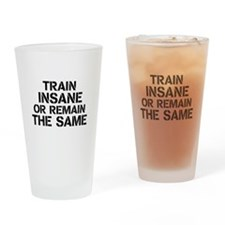 Train insane or remain the same Drinking Glass