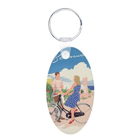 a, c.1956 @colour lithoA - Aluminum Oval Keychain