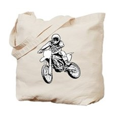 Playing in the dirt with a motorbike Tote Bag