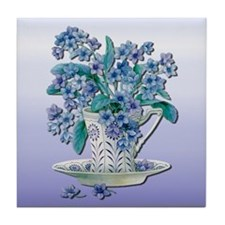 Blue flowers in a teacup Tile Coaster