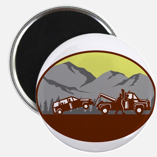 Car being towed Away Mountains Oval Woodcut Magnet