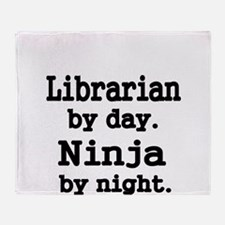 Librarian day. Ninja by Night Throw Blanket