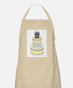 Gay men in leather on top of a cake. Apron