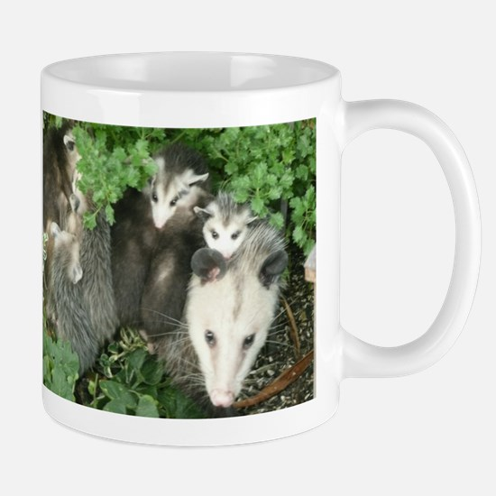 mother opossum in garden with babies face Mugs