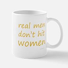 real men don't hit women Mug