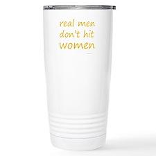real men don't hit women Travel Mug