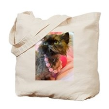 Freida wearing her favorite pink pearls Tote Bag