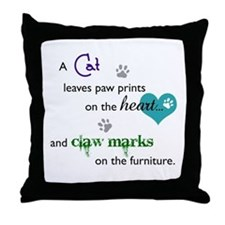 A cat leaves paw prints... Throw Pillow