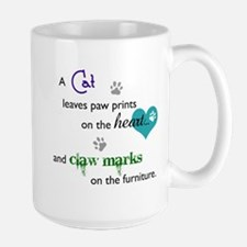 A cat leaves paw prints... Large Mug