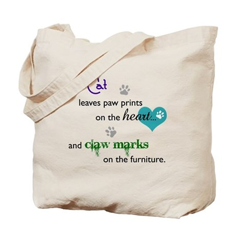 A cat leaves paw prints... Tote Bag