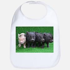 4 micro pigs in a row Bib