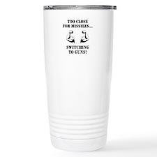 Missiles To Guns Travel Mug