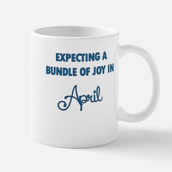 Expecting a bundle of joy in April Mug