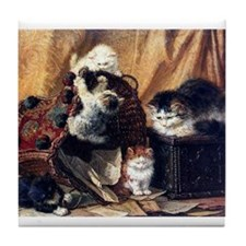 Basket of playing kittens Tile Coaster