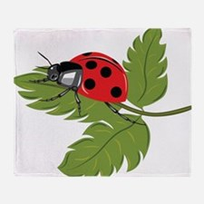 Ladybug on Leaf Throw Blanket