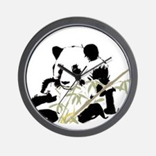 Giant panda eating bamboo Wall Clock