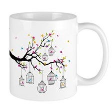 tree branch with birds and birdcages Mug