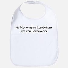 Norwegian Lundehund ate my ho Bib