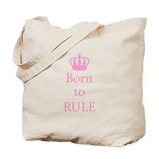Born to rule, text design with pink crown for baby