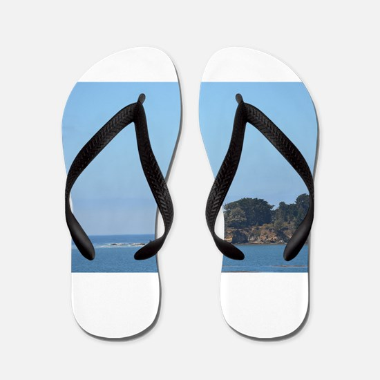 Rock outcropping with crystal blue water Flip Flop