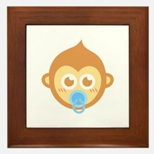 Cute baby monkey with blue pacifier Framed Tile