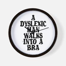 DYSLEXIC MAN WALKS INTO A BRA Wall Clock